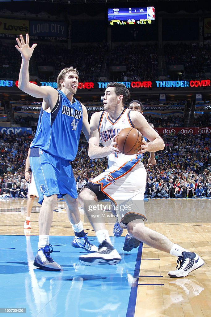 <a gi-track='captionPersonalityLinkClicked' href=/galleries/search?phrase=Nick+Collison&family=editorial&specificpeople=202843 ng-click='$event.stopPropagation()'>Nick Collison</a> #4 of the Oklahoma City Thunder drives to the basket against <a gi-track='captionPersonalityLinkClicked' href=/galleries/search?phrase=Dirk+Nowitzki&family=editorial&specificpeople=201490 ng-click='$event.stopPropagation()'>Dirk Nowitzki</a> #41 of the Dallas Mavericks on February 04, 2013 at the Chesapeake Energy Arena in Oklahoma City, Oklahoma.