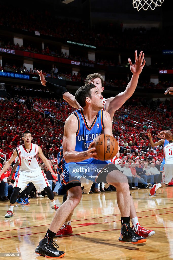 Nick Collison #4 of the Oklahoma City Thunder drives to the basket against Omer Asik #3 of the Houston Rockets in Game Six of the Western Conference Quarterfinals during the 2013 NBA Playoffs on May 3, 2013 at the Toyota Center in Houston, Texas.