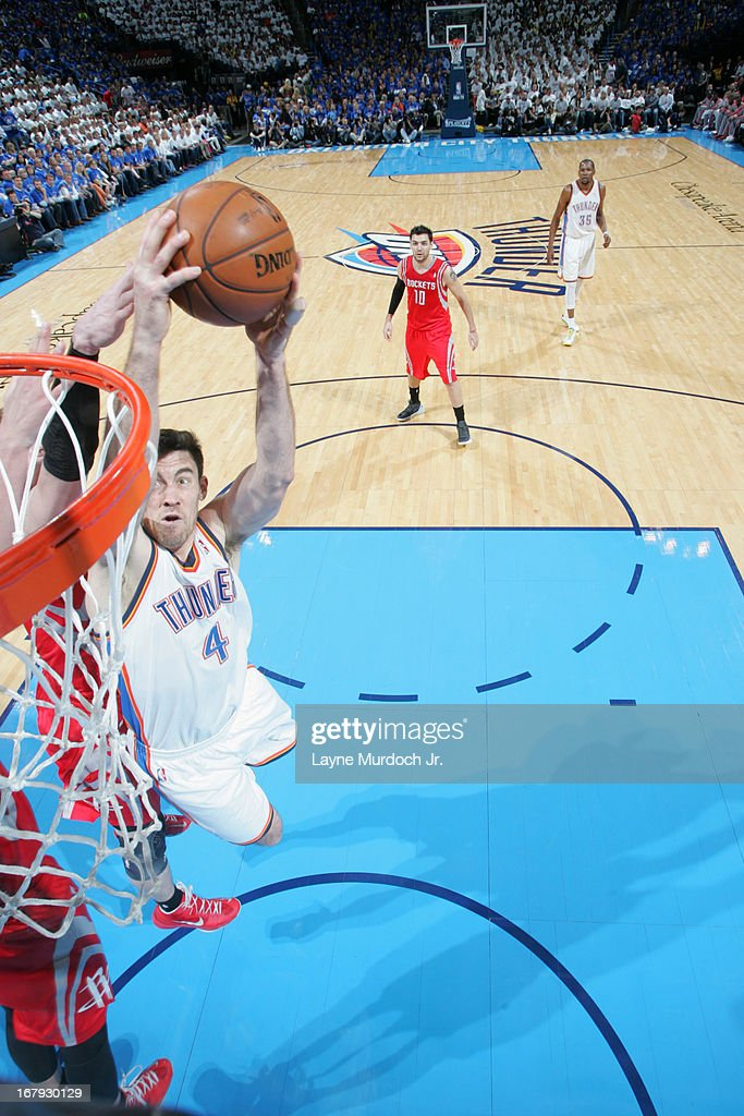 <a gi-track='captionPersonalityLinkClicked' href=/galleries/search?phrase=Nick+Collison&family=editorial&specificpeople=202843 ng-click='$event.stopPropagation()'>Nick Collison</a> #4 of the Oklahoma City Thunder drives to the basket against the Houston Rockets in Game Two of the Western Conference Quarter Finals during the 2013 NBA playoffs on April 24, 2013 at the Chesapeake Energy Arena in Oklahoma City, Oklahoma.