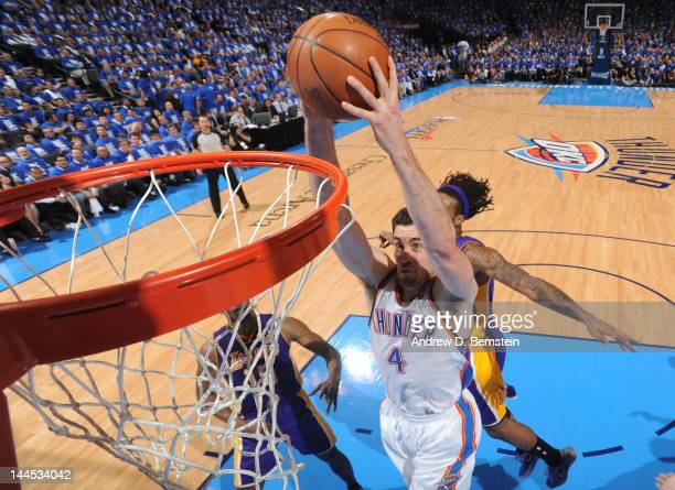 Nick Collison of the Oklahoma City Thunder dunks the ball during the Game One of the Western Conference Semifinals between the Los Angeles Lakers and...