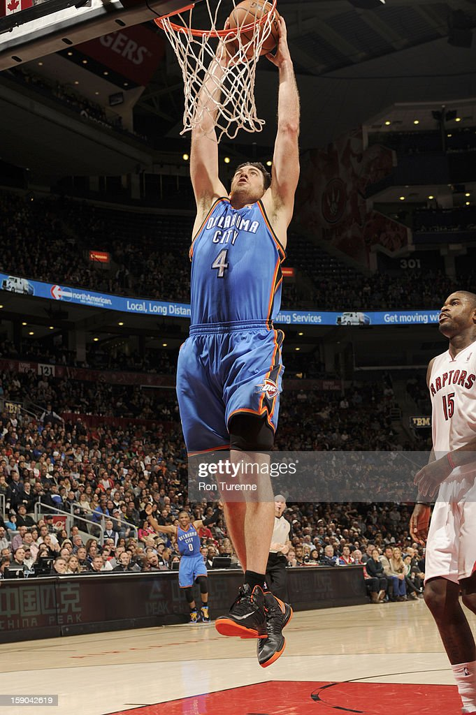 <a gi-track='captionPersonalityLinkClicked' href=/galleries/search?phrase=Nick+Collison&family=editorial&specificpeople=202843 ng-click='$event.stopPropagation()'>Nick Collison</a> #4 of the Oklahoma City Thunder dunks the ball during the game between the Toronto Raptors and the Oklahoma City Thunder on January 6, 2013 at the Air Canada Centre in Toronto, Ontario, Canada.