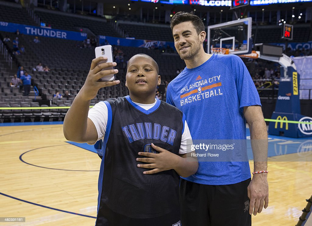 Nick Collison #4 of the Oklahoma City Thunder during the annual season ticket holder event at the Chesapeake Arena on March 30, 2014 in Oklahoma City, Oklahoma.
