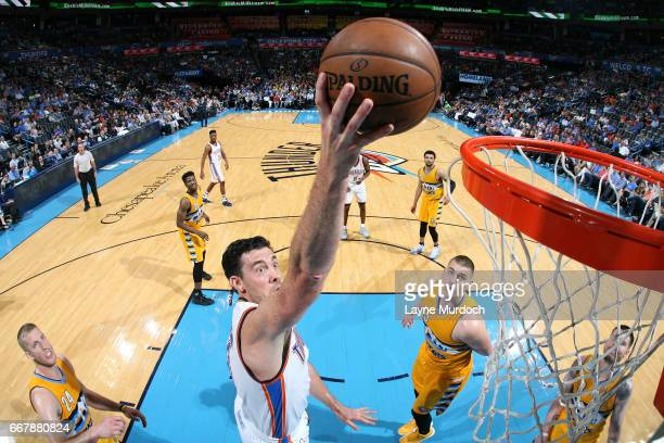 Nick Collison of the Oklahoma City Thunder goes for a dunk during the game against the Denver Nuggets on April 12 2017 at Chesapeake Energy Arena in...