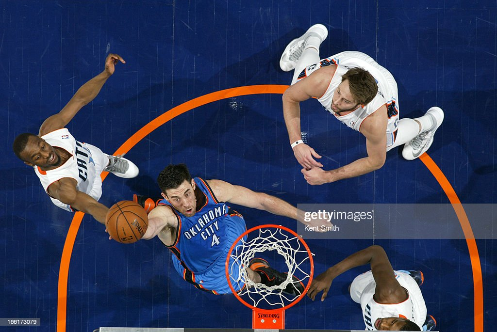 <a gi-track='captionPersonalityLinkClicked' href=/galleries/search?phrase=Nick+Collison&family=editorial&specificpeople=202843 ng-click='$event.stopPropagation()'>Nick Collison</a> #4 of the Oklahoma City Thunder goes up for a rebound against the Charlotte Bobcats at the Time Warner Cable Arena on March 8, 2013 in Charlotte, North Carolina.
