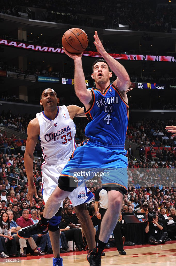 Nick Collison #4 of the Oklahoma City Thunder goes up for a shot ahead of Grant Hill #33 of the Los Angeles Clippers at Staples Center on March 3, 2013 in Los Angeles, California.