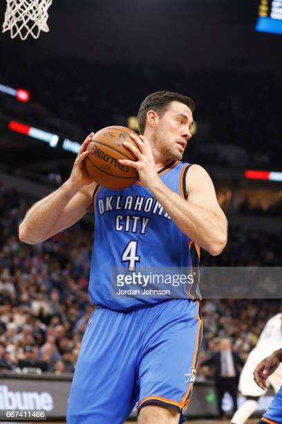 Nick Collison of the Oklahoma City Thunder grabs the rebound against the Minnesota Timberwolves on April 11 2017 at Target Center in Minneapolis...