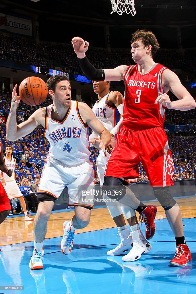 <a gi-track='captionPersonalityLinkClicked' href=/galleries/search?phrase=Nick+Collison&family=editorial&specificpeople=202843 ng-click='$event.stopPropagation()'>Nick Collison</a> #4 of the Oklahoma City Thunder looks to pass the ball in the lane against Omer Asik #3 of the Houston Rockets in Game One of the Western Conference Quarterfinals during the 2013 NBA playoffs on April 21, 2013 at the Chesapeake Energy Arena in Oklahoma City, Oklahoma.