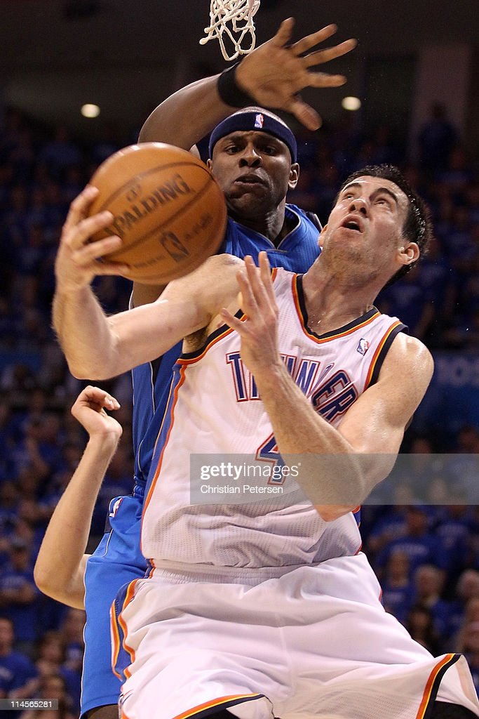 <a gi-track='captionPersonalityLinkClicked' href=/galleries/search?phrase=Nick+Collison&family=editorial&specificpeople=202843 ng-click='$event.stopPropagation()'>Nick Collison</a> #4 of the Oklahoma City Thunder looks to shoot against <a gi-track='captionPersonalityLinkClicked' href=/galleries/search?phrase=Brendan+Haywood&family=editorial&specificpeople=202010 ng-click='$event.stopPropagation()'>Brendan Haywood</a> #33 of the Dallas Mavericks in the second half in Game Four of the Western Conference Finals during the 2011 NBA Playoffs at Oklahoma City Arena on May 23, 2011 in Oklahoma City, Oklahoma.