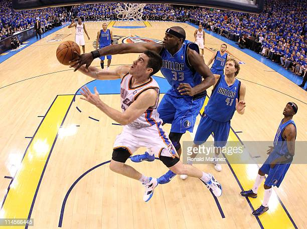 Nick Collison of the Oklahoma City Thunder looks to shoot against Brendan Haywood of the Dallas Mavericks in the second half in Game Four of the...