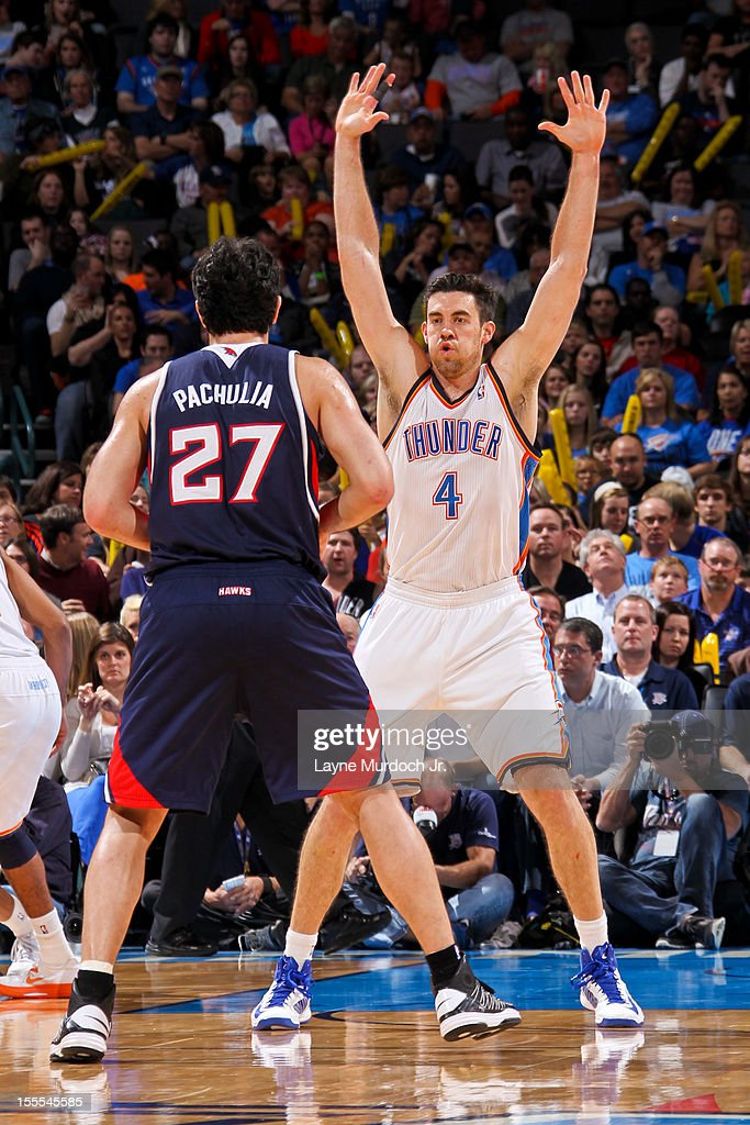 <a gi-track='captionPersonalityLinkClicked' href=/galleries/search?phrase=Nick+Collison&family=editorial&specificpeople=202843 ng-click='$event.stopPropagation()'>Nick Collison</a> #4 of the Oklahoma City Thunder plays defense against <a gi-track='captionPersonalityLinkClicked' href=/galleries/search?phrase=Zaza+Pachulia&family=editorial&specificpeople=202939 ng-click='$event.stopPropagation()'>Zaza Pachulia</a> #27 of the Atlanta Hawks on November 4, 2012 at the Chesapeake Energy Arena in Oklahoma City, Oklahoma.