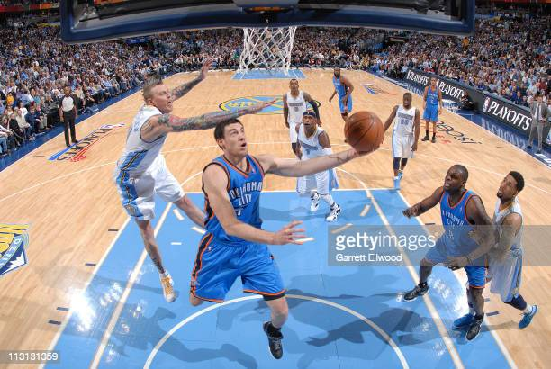 Nick Collison of the Oklahoma City Thunder shoots against Chris Andersen of the Denver Nuggets in Game Three of the Western Conference Quarterfinals...