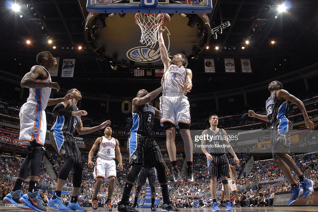 <a gi-track='captionPersonalityLinkClicked' href=/galleries/search?phrase=Nick+Collison&family=editorial&specificpeople=202843 ng-click='$event.stopPropagation()'>Nick Collison</a> #4 of the Oklahoma City Thunder shoots against <a gi-track='captionPersonalityLinkClicked' href=/galleries/search?phrase=Kyle+O%27Quinn&family=editorial&specificpeople=9027719 ng-click='$event.stopPropagation()'>Kyle O'Quinn</a> #2 of the Orlando Magic on March 22, 2013 at Amway Center in Orlando, Florida.