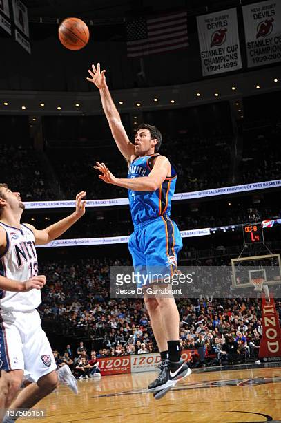 Nick Collison of the Oklahoma City Thunder shoots against Mehmet Okur of the New Jersey Nets during the game on January 21 2012 at Prudential Center...