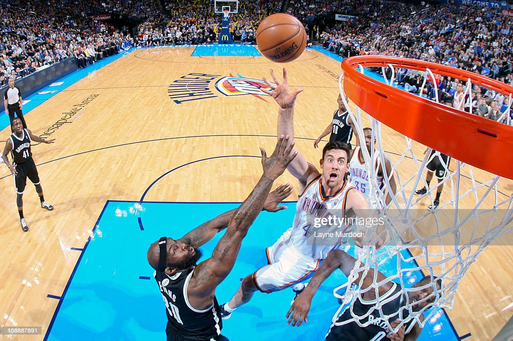 <a gi-track='captionPersonalityLinkClicked' href=/galleries/search?phrase=Nick+Collison&family=editorial&specificpeople=202843 ng-click='$event.stopPropagation()'>Nick Collison</a> #4 of the Oklahoma City Thunder shoots in the lane against <a gi-track='captionPersonalityLinkClicked' href=/galleries/search?phrase=Reggie+Evans&family=editorial&specificpeople=202254 ng-click='$event.stopPropagation()'>Reggie Evans</a> #30 and <a gi-track='captionPersonalityLinkClicked' href=/galleries/search?phrase=Andray+Blatche&family=editorial&specificpeople=4282797 ng-click='$event.stopPropagation()'>Andray Blatche</a> #0 of the Brooklyn Nets on January 2, 2013 at the Chesapeake Energy Arena in Oklahoma City, Oklahoma.