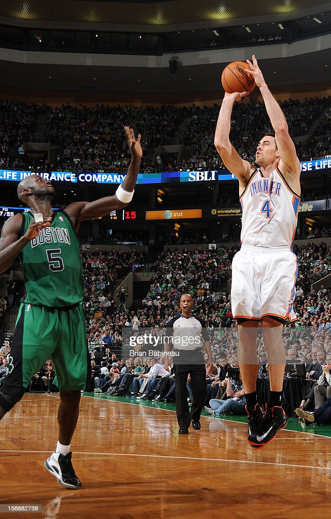 Nick Collison #4 of the Oklahoma City Thunder shoots the ball against Kevin Garnett #5 of the Boston Celtics on November 23, 2012 at the TD Garden in Boston, Massachusetts.
