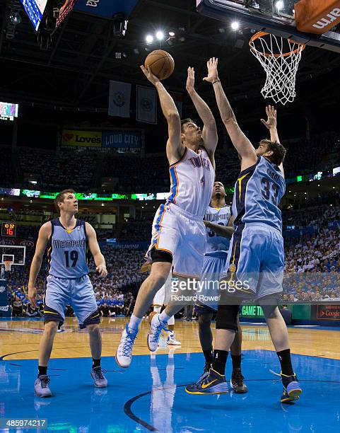 Nick Collison of the Oklahoma City Thunder takes a shot against the Memphis Grizzlies in Game Two of the Western Conference Quarterfinals during the...