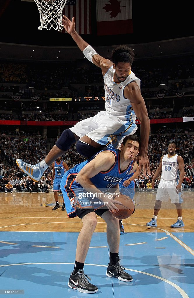 <a gi-track='captionPersonalityLinkClicked' href=/galleries/search?phrase=Nick+Collison&family=editorial&specificpeople=202843 ng-click='$event.stopPropagation()'>Nick Collison</a> #4 of the Oklahoma City Thunder tries to get off a shot but is fouled by <a gi-track='captionPersonalityLinkClicked' href=/galleries/search?phrase=Nene+Hilario+-+Basketball&family=editorial&specificpeople=4250456 ng-click='$event.stopPropagation()'>Nene Hilario</a> #31 of the Denver Nuggets in Game Four of the Western Conference Quarterfinals in the 2011 NBA Playoffs on April 24, 2011 at the Pepsi Center in Denver, Colorado. The Nuggets defeated the Thunder 104-101.