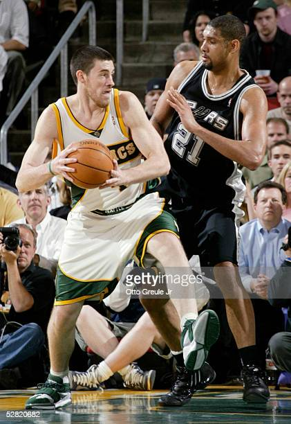 Nick Collison of the Seattle SuperSonics drives against Tim Duncan of the San Antonio Spurs in Game three of the Western Conference Semifinals during...