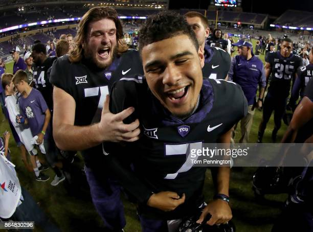 Nick Cominos of the TCU Horned Frogs celebrtes with Kenny Hill of the TCU Horned Frogs after the TCU Horned Frogs beat the Kansas Jayhawks 430 at...