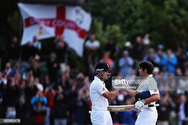 Nick Compton congratulates Alastair Cook of England on his century during day four of the First Test match between New Zealand and England at...