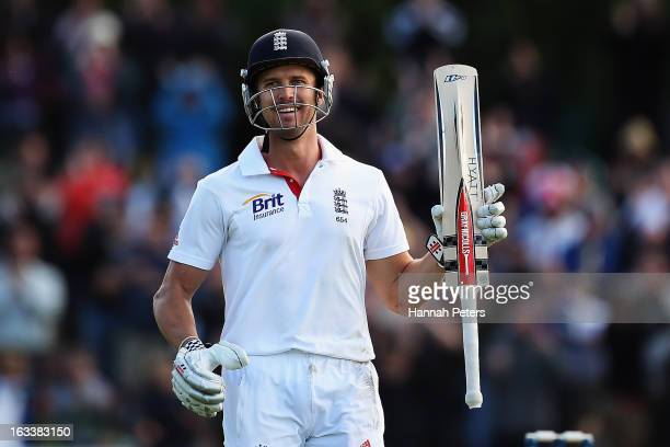 Nick Compton of England celebrates after scoring a century during day four of the First Test match between New Zealand and England at University Oval...