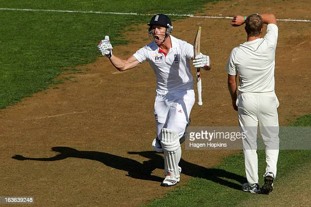 Nick Compton of England celebrates his century while Neil Wagner of New Zealand looks on during day one of the Second Test match between New Zealand...