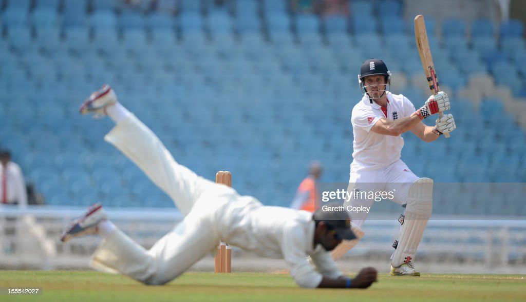 <a gi-track='captionPersonalityLinkClicked' href=/galleries/search?phrase=Nick+Compton&family=editorial&specificpeople=654760 ng-click='$event.stopPropagation()'>Nick Compton</a> of England hits past a Mumbai A fielder during day three of the tour match between Mumbai A and England at The Dr D.Y. Palit Sports Stadium on November 5, 2012 in Mumbai, India.