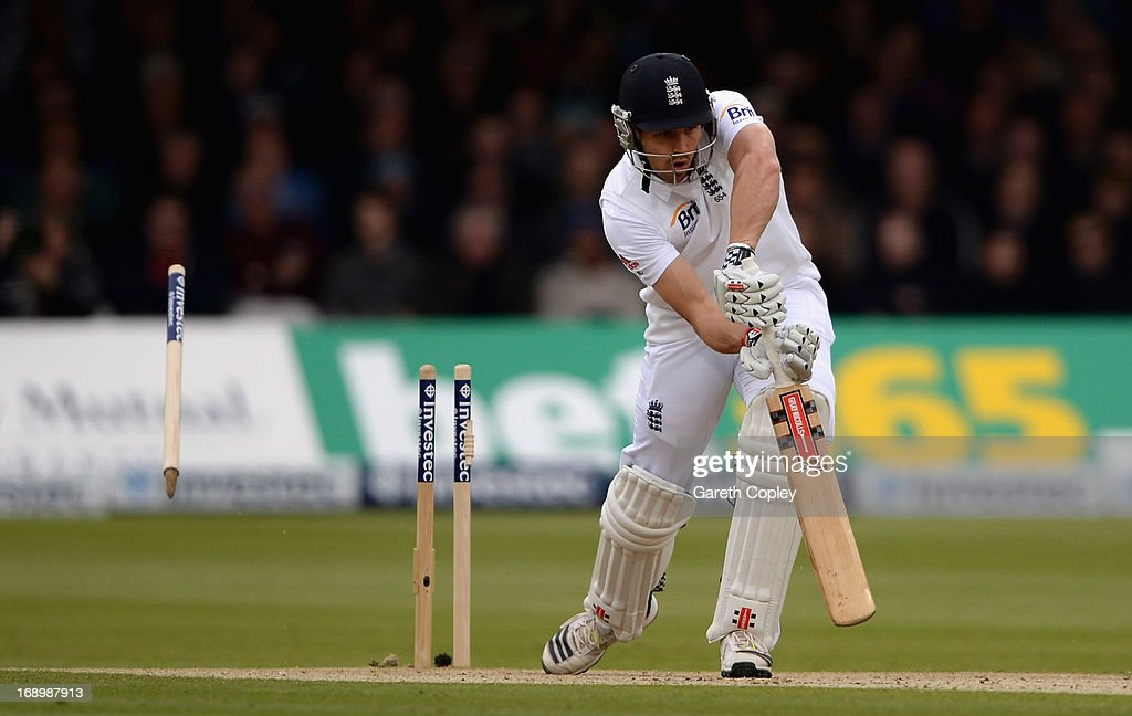 <a gi-track='captionPersonalityLinkClicked' href=/galleries/search?phrase=Nick+Compton&family=editorial&specificpeople=654760 ng-click='$event.stopPropagation()'>Nick Compton</a> of England is bowled by Neil Wagner of New Zealand during day three of 1st Investec Test match between England and New Zealand at Lord's Cricket Ground on May 18, 2013 in London, England.