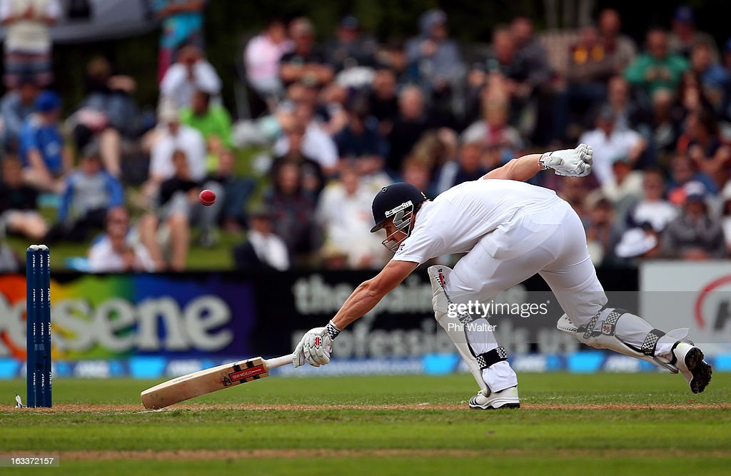 Nick Compton of England stretches to make his ground during day four of the First Test match between New Zealand and England at University Oval on March 9, 2013 in Dunedin, New Zealand.