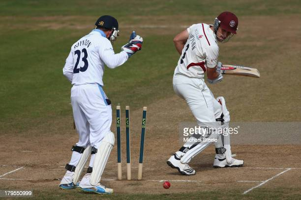 Nick Compton of Somerset is bowled for 95 by Antonio Palladino of Derbyshire during day three of the LV County Championship Division One match...