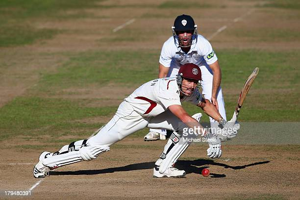 Nick Compton of Somerset plays to the offside as Richard Johnson of Derbyshire looks on during day two of the LV County Championship Division One...