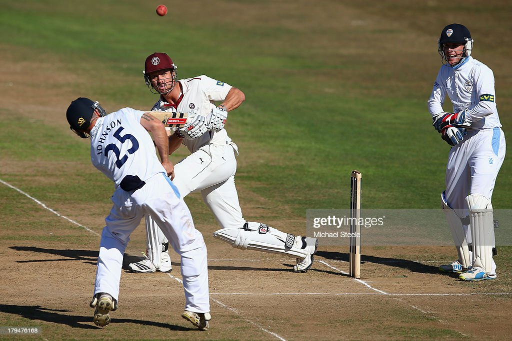 <a gi-track='captionPersonalityLinkClicked' href=/galleries/search?phrase=Nick+Compton&family=editorial&specificpeople=654760 ng-click='$event.stopPropagation()'>Nick Compton</a> (C) of Somerset sees his legside shot bounce off Richard Johnson (L) of Derbyshire as wicketkeeper Thomas Poynton (R) looks on during day two of the LV County Championship Division One match between Somerset and Derbyshire at The County Ground on September 4, 2013 in Taunton, England.