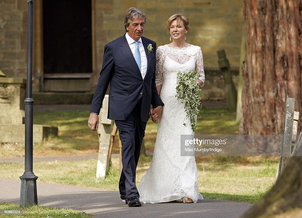 Nick Cook and Eimear Montgomerie (ex-wife of golfer Colin Montgomerie) leave St. Nicholas Church after their wedding on September 20, 2009 in Cranleigh, England.