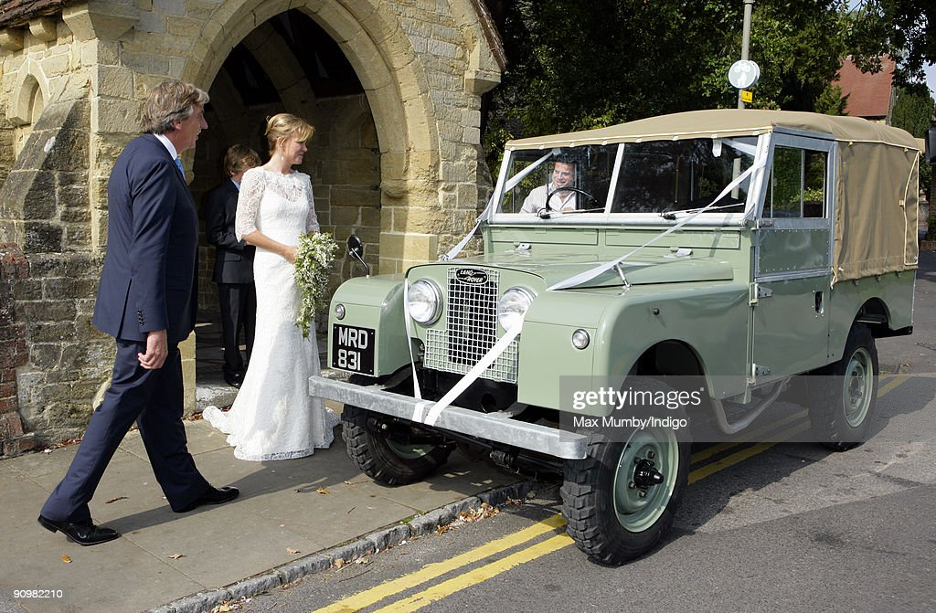 Nick Cook and Eimear Montgomerie (ex-wife of golfer Colin Montgomerie) leave St. Nicholas Church in a canvas roofed Land Rover after their wedding on September 20, 2009 in Cranleigh, England.
