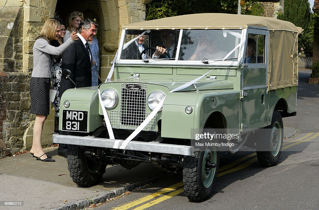 Nick Cook and Eimear Montgomerie leave St. Nicholas Church in a canvas roofed Land Rover after their wedding on September 20, 2009 in Cranleigh, England.