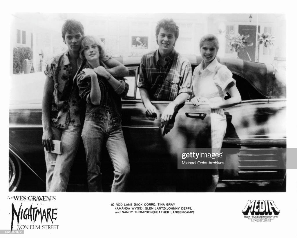 Nick Corri Amanda Wyss Johnny Depp and Heather Langenkamp posing beside car in a scene from the film 'A Nightmare On Elm Street' 1984