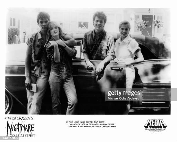 Nick Corri Amanda Wyss Johnny Depp and Heather Langenkamp posing beside car in a scene from the film 'A Nightmare On Elm Street' 1984