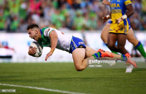 Nick Cotric of the Raiders dives to score during the round five NRL match between the Canberra Raiders and the Parramatta Eels at GIO Stadium on...