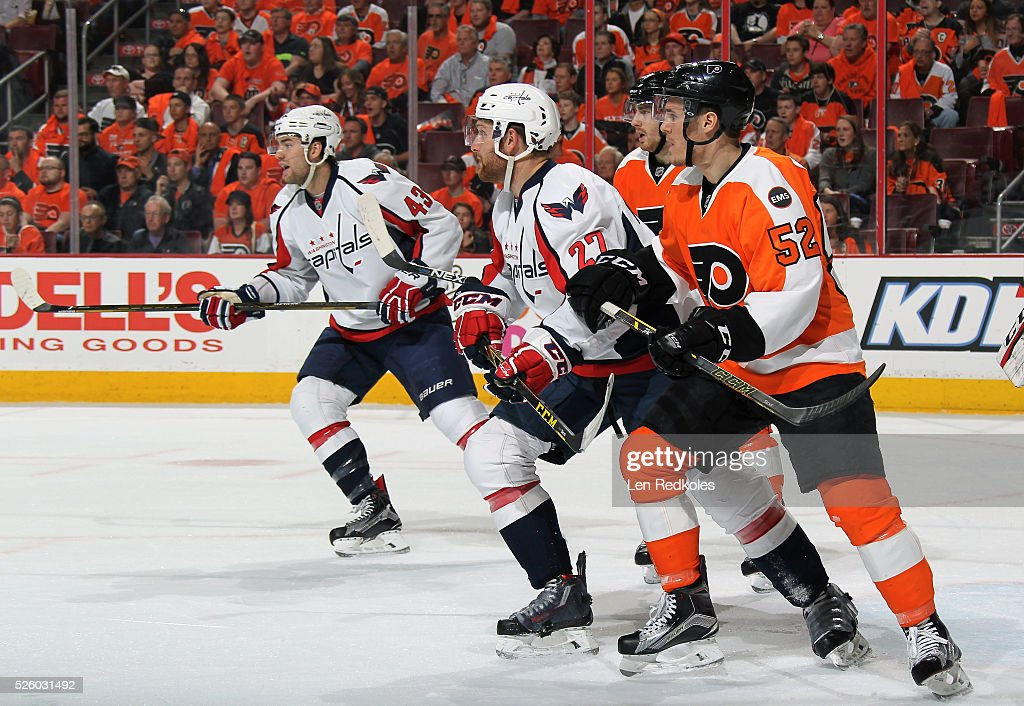Nick Cousins and Matt Read of the Philadelphia Flyers battle against Karl Alnzer and Tom Wilson of the Washington Capitals in Game Four of the...