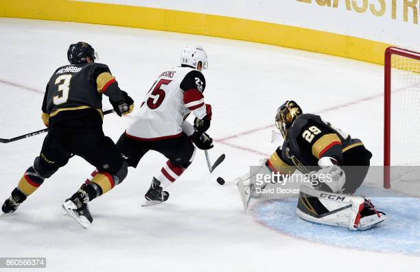 Nick Cousins of the Arizona Coyotes shoots againt goalie MarcAndre Fleury of the Vegas Golden Knights at TMobile Arena on October 10 2017 in Las...