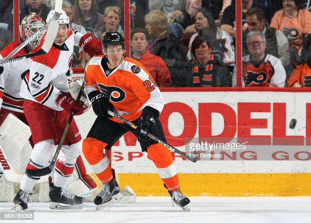Nick Cousins of the Philadelphia Flyers battles against Brett Pesce of the Carolina Hurricanes on April 9 2017 at the Wells Fargo Center in...