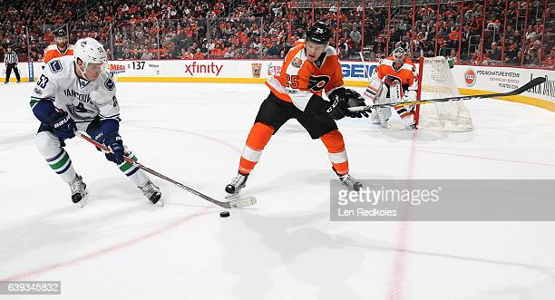 Nick Cousins of the Philadelphia Flyers battles for the puck against Bo Horvat of the Vancouver Canucks on January 12 2017 at the Wells Fargo Center...