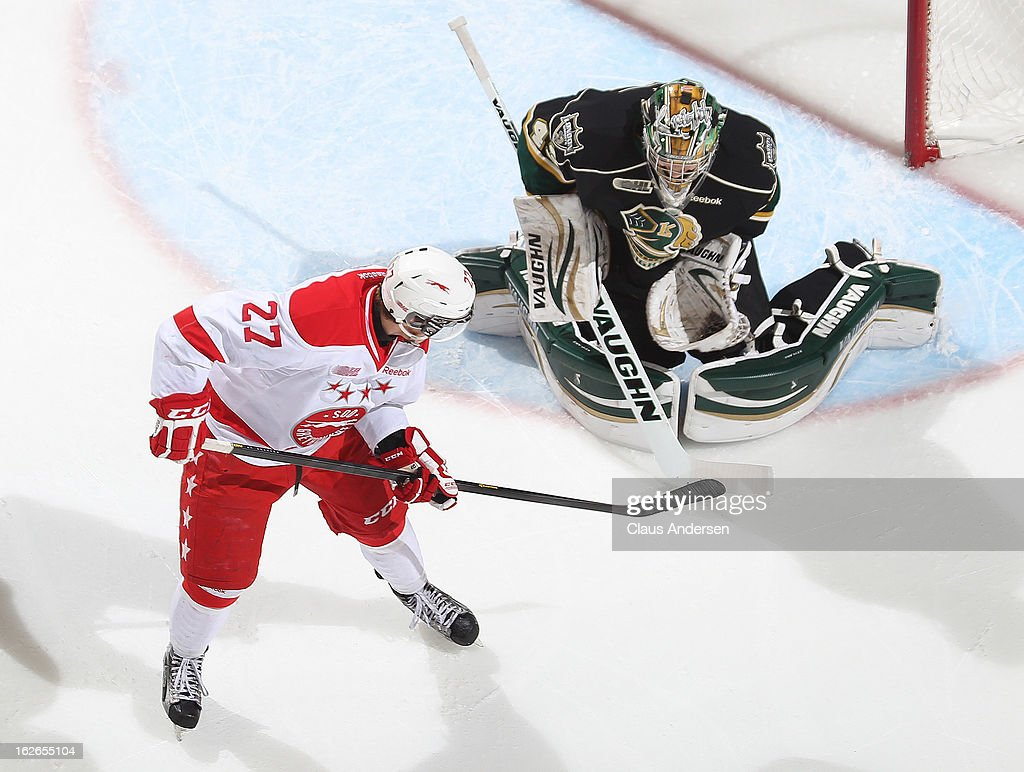 Nick Cousins #27 of the Sault Ste. Marie Greyhounds tries to tip a shot past Anthony Stolarz #43 of the London Knights in an OHL game on February 22, 2013 at the Budweiser Gardens in London, Ontario, Canada. The Knights defeated the Greyhounds 4-3 in overtime.