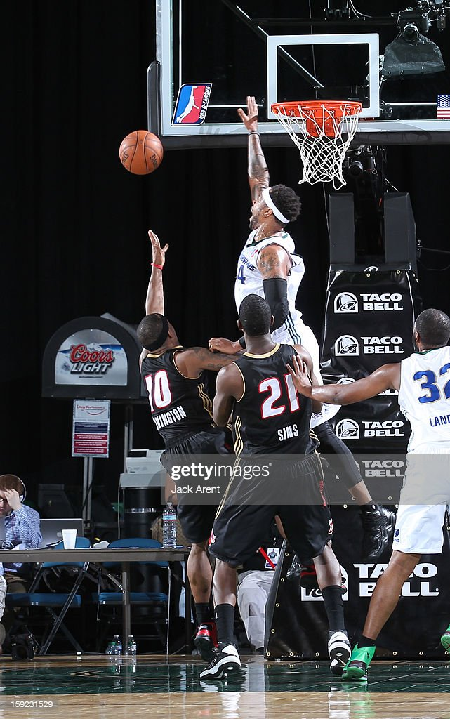 Nick Covington #10 of the Erie BayHawks has his shot blocked by Antoine Wright #34 of the Reno Bighorns during the 2013 NBA D-League Showcase on January 9, 2013 at the Reno Events Center in Reno, Nevada.