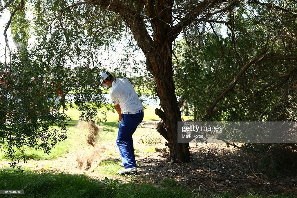 Nick Cullen of Australia plays a shot from the rough during round three of the 2012 Australian Open at The Lakes Golf Club on December 8, 2012 in Sydney, Australia.