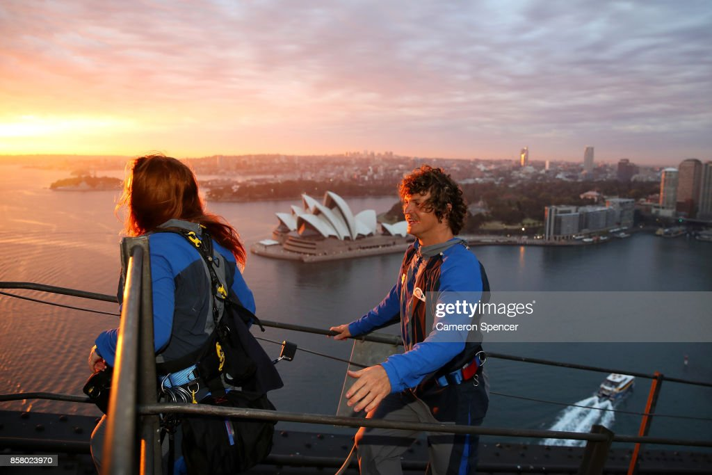 Nick (The Honey Badger) Cummins delivers the first news bulletin for Aussie News Today from the top of the Sydney Harbour Bridge on October 6, 2017 in Sydney, Australia.