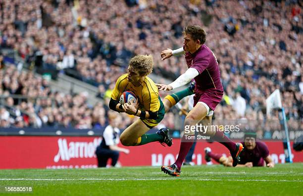 Nick Cummins of Australia scores a try past Toby Flood of England during the QBE International match between England and Australia at Twickenham...