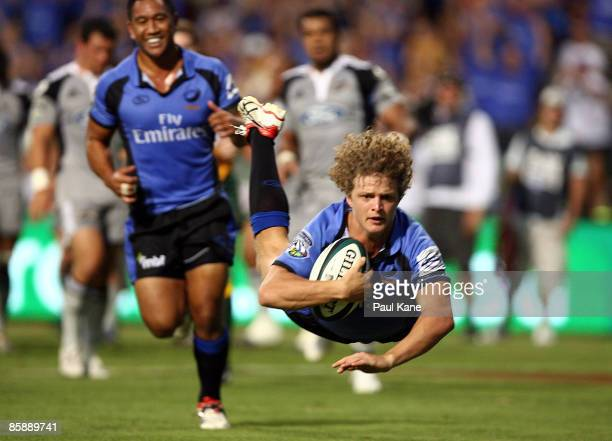 Nick Cummins of the Force dives for a try during the round nine Super 14 match between the Western Force and the Hurricanes at Subiaco Oval on April...