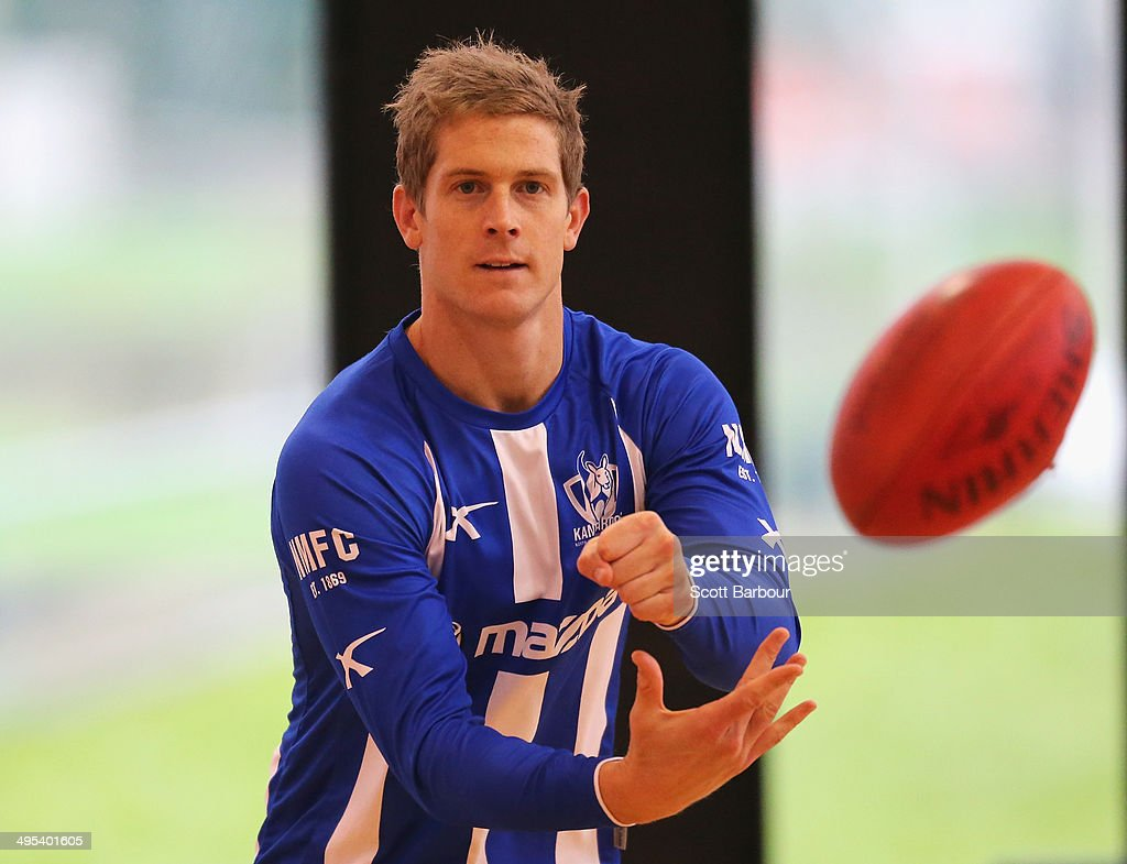 <a gi-track='captionPersonalityLinkClicked' href=/galleries/search?phrase=Nick+Dal+Santo&family=editorial&specificpeople=213937 ng-click='$event.stopPropagation()'>Nick Dal Santo</a> passes the ball during a North Melbourne Kangaroos AFL training session at Arden Street Ground on June 3, 2014 in Melbourne, Australia.