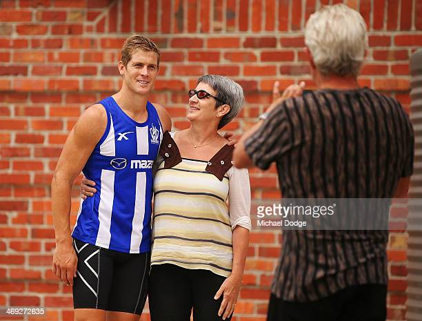 Nick Dal Santo poses with a fan during a North Melbourne Kangaroos AFL training session at Arden Street Ground on February 14 2014 in Melbourne...
